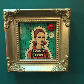Mini mixed media personality adjustment pieces by local artist Delaine Derry Green. $25.00.