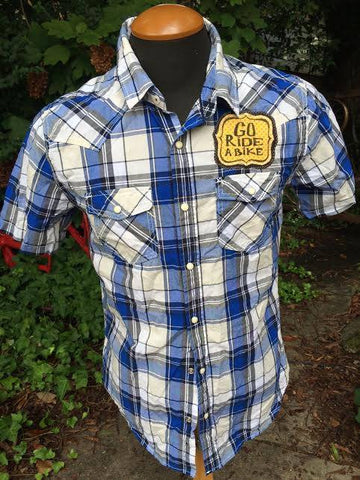 Revamped Western shirts by local artist Véro. $35.00