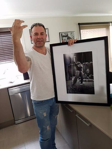 Clint brought his mate a framed Zo Damage photo of Neil Fallon (Clutch)!