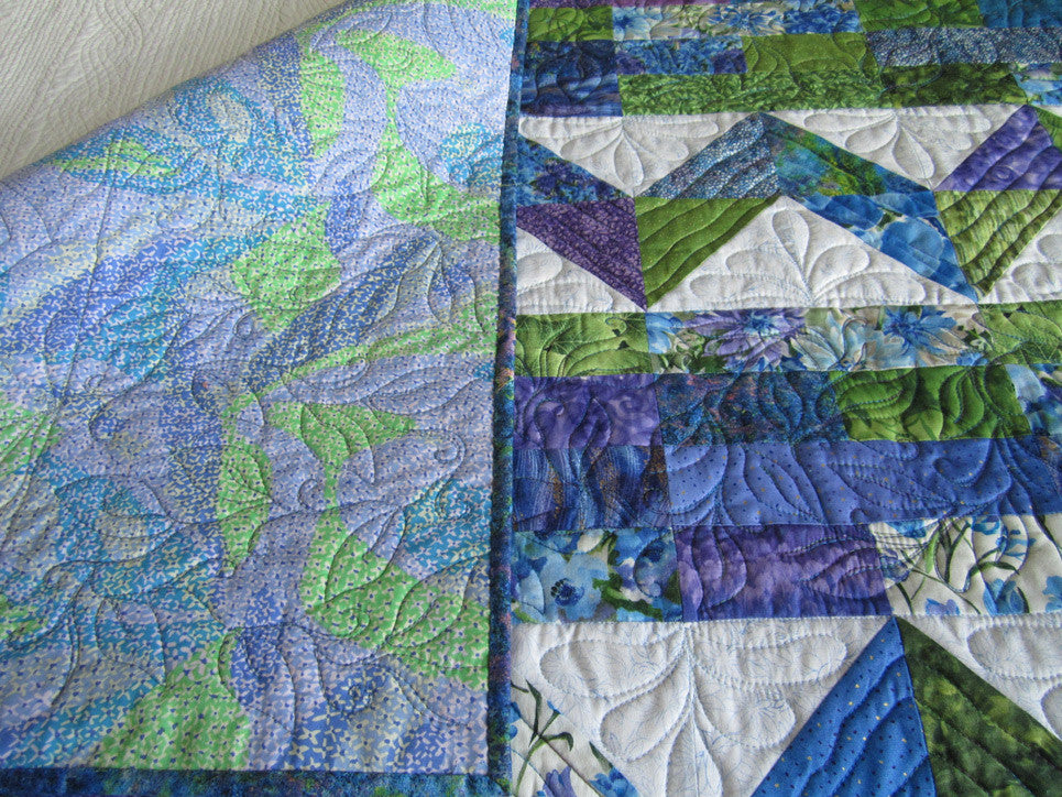 Patchwork Quilt With Blue Green And Purple Colors
