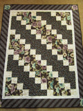 Floral Quilt with Brown Background