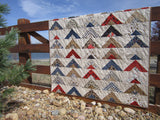 Patchwork Quilt with Arrows and Wildlife