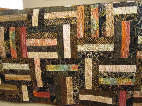 Batik Patchwork Quilt with Mostly Black, Brown and Tan Colors
