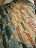 Batik Quilt in Green and Peach Tones