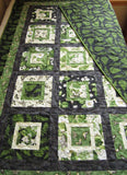 Green Patchwork Quilt with Butterflies, Leaves and Flowers in Nature
