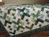 Batik Quilt Featuring Green and Teal Fabrics