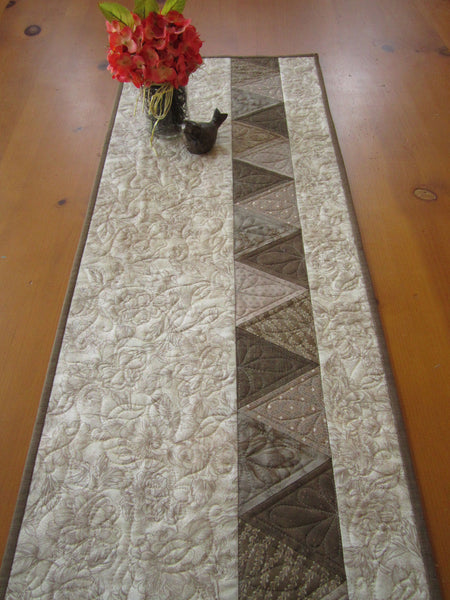 Quilted Table Runner with a Geometric and Floral Design