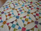 Spring Batik Quilted Tale Topper in Rainbow Colors