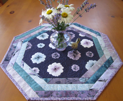 Handmade Table Topper Featuring Flowers on a Purple Background