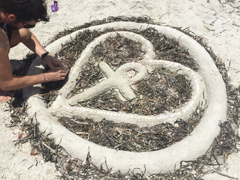 planet love life symbol sand art sculpture beach sandcastle