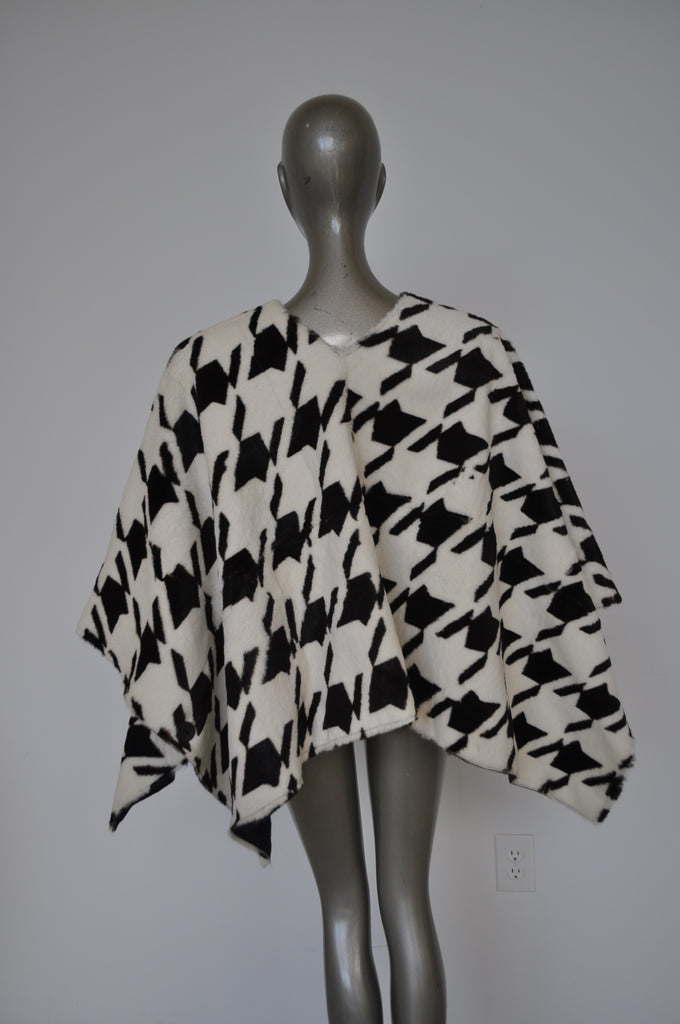 Fabulous fur cape with houndstooth print.