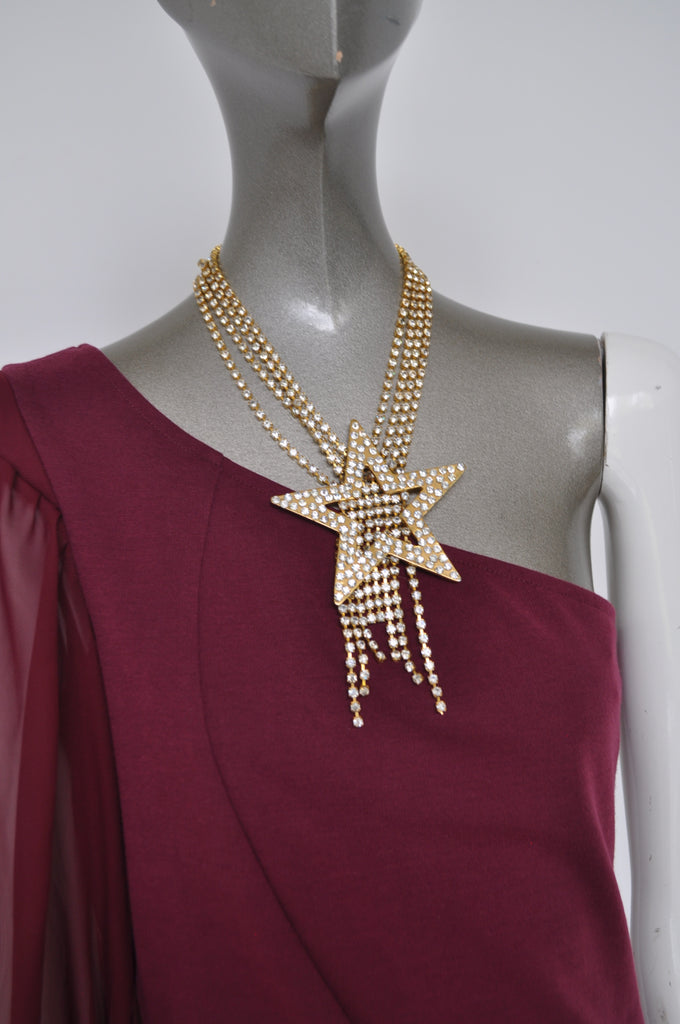 Rare Moschino necklace from the 80s. Huge star with christals