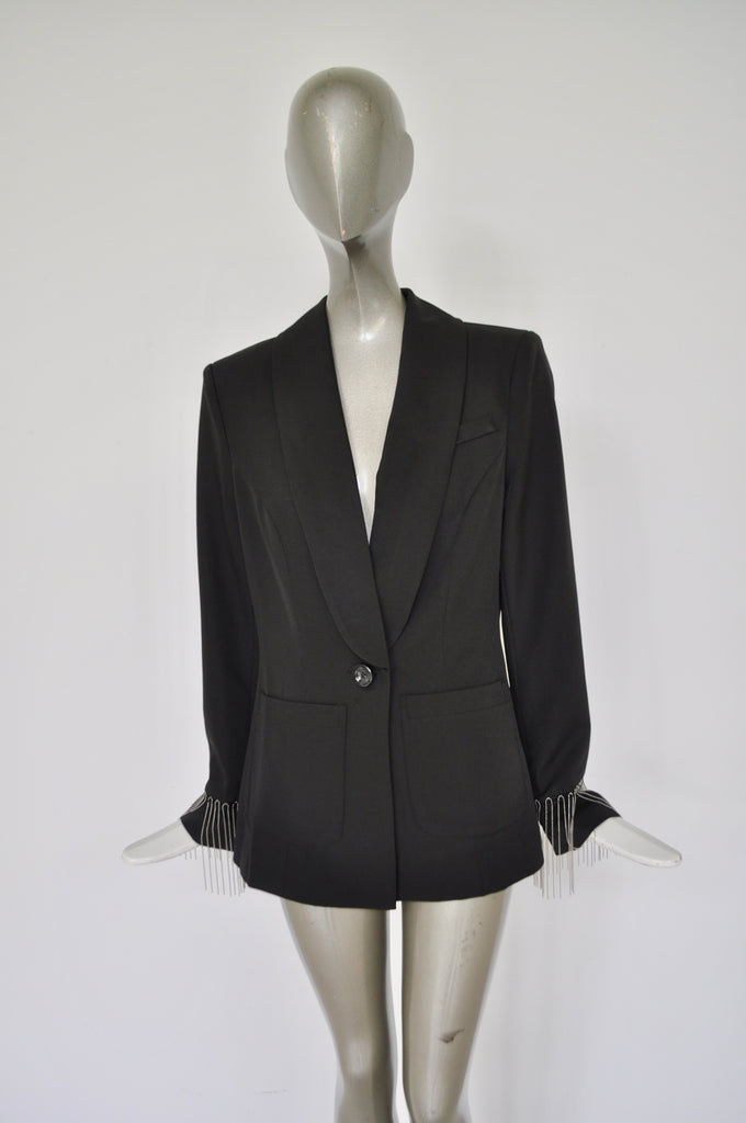 Avantgarde jacket with metal strings attached