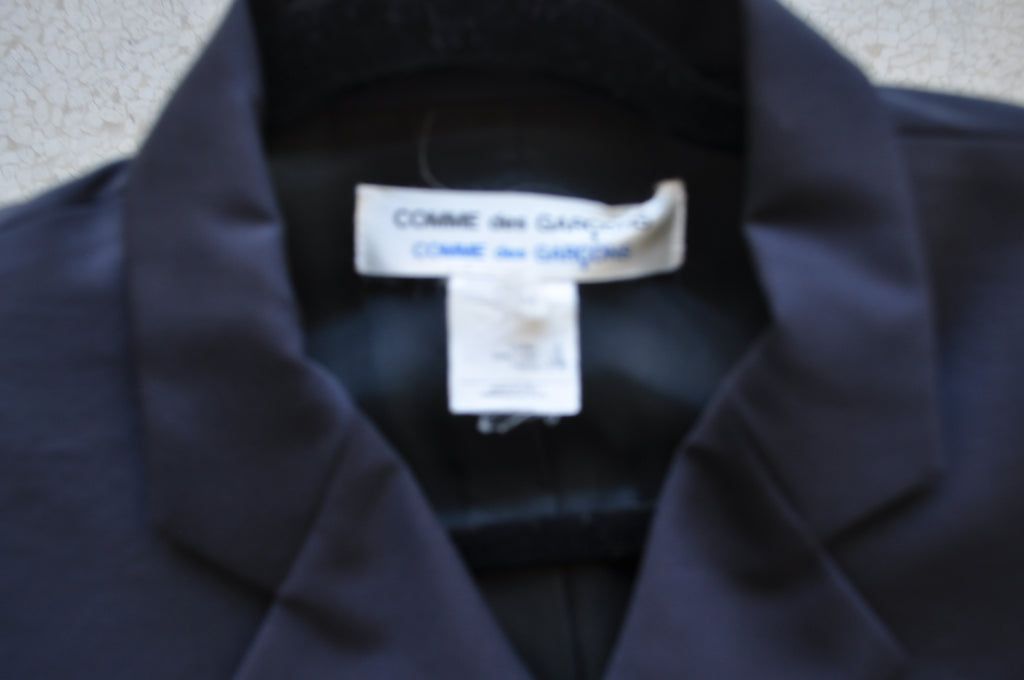 Comme des Garçons apron dress and jacket from 89