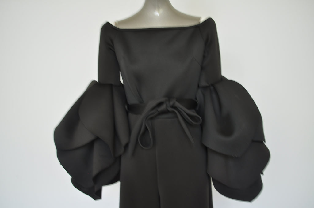 Opulent jumpsuit with fabulous sleeves.