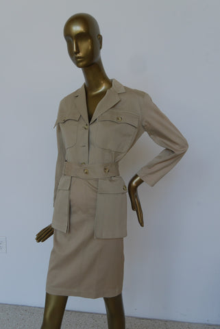 Avantgarde Trenchcoat with large hood and tassels.