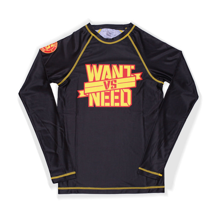 ADULT WANT VS NEED BY ANY MEANS RASHGUARD - BLACK