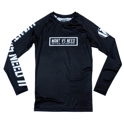 WANT VS NEED RASHGUARD- BLACK