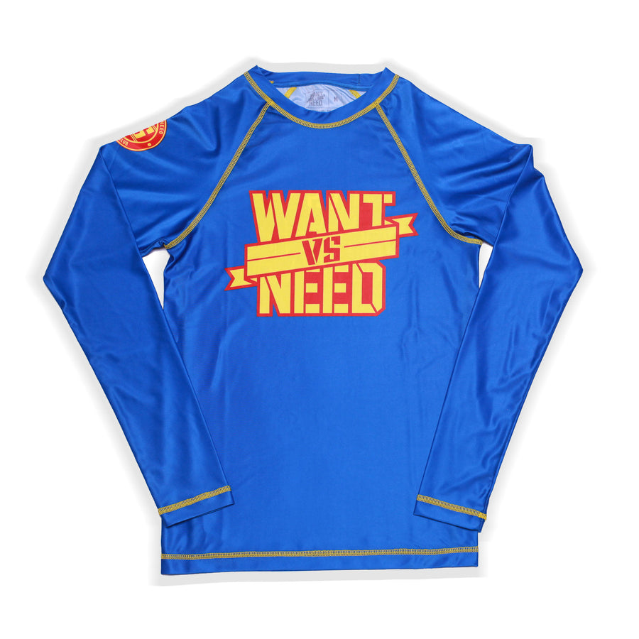 KIDS WANT VS NEED RASHGUARD - BLUE