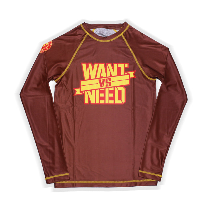 ADULT WANT VS NEED BY ANY MEANS RASHGUARD - BROWN