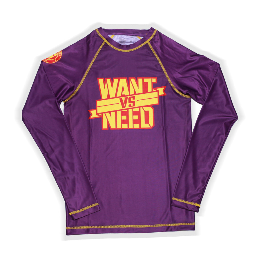 ADULT WANT VS NEED BY ANY MEANS RASHGUARD - PURPLE