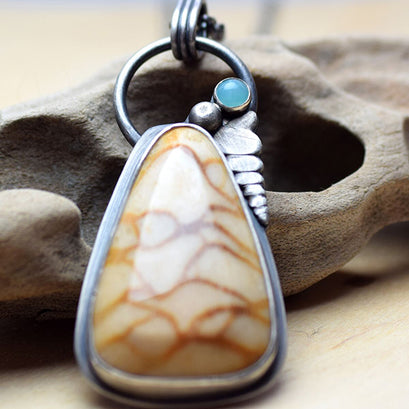 Fossilized coral and blue chalcedony pendant front view
