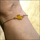 yellow sapphire and silk bracelet artisan jewelry ventura boulevard sherman oaks on wrist