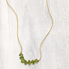 norosesjewelry.com - Los Angeles - Seven Stone Necklace Peridot Gold