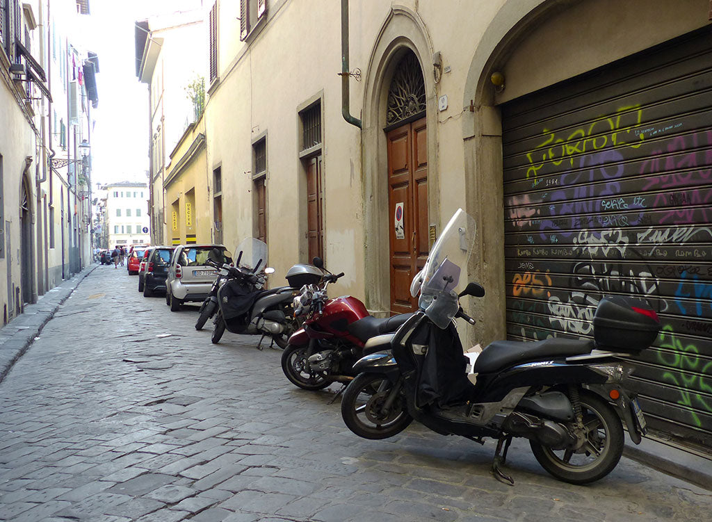 Motorcycles in a narrow alleyway in Florence