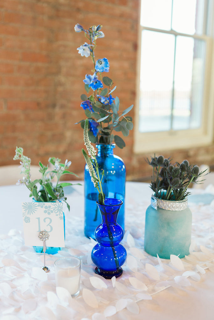 blue glass bottles gloral arrangement