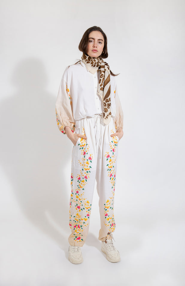 Load image into Gallery viewer, Denny Jumpsuit - All Things Mochi - beige jumpsuit with floral print