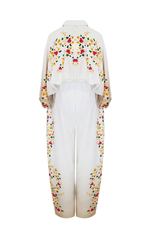Load image into Gallery viewer, Denny Jumpsuit - All Things Mochi - beige jumpsuit with floral print (back)