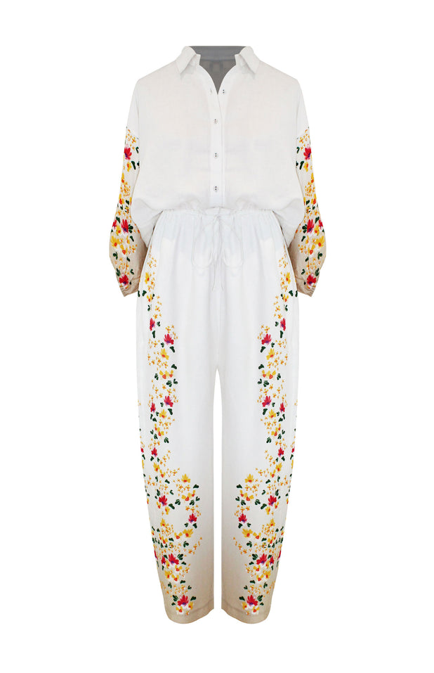Load image into Gallery viewer, Denny Jumpsuit - All Things Mochi - beige jumpsuit with floral print (front)