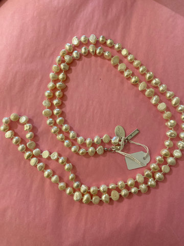 "White Fresh Water Pearl Necklace, single strand Approx 42"" long (106 cm)"
