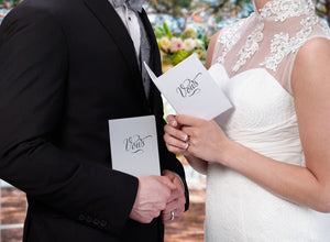 Bride and Groom Holding Wedding Vow Books - Love Wedding Shop