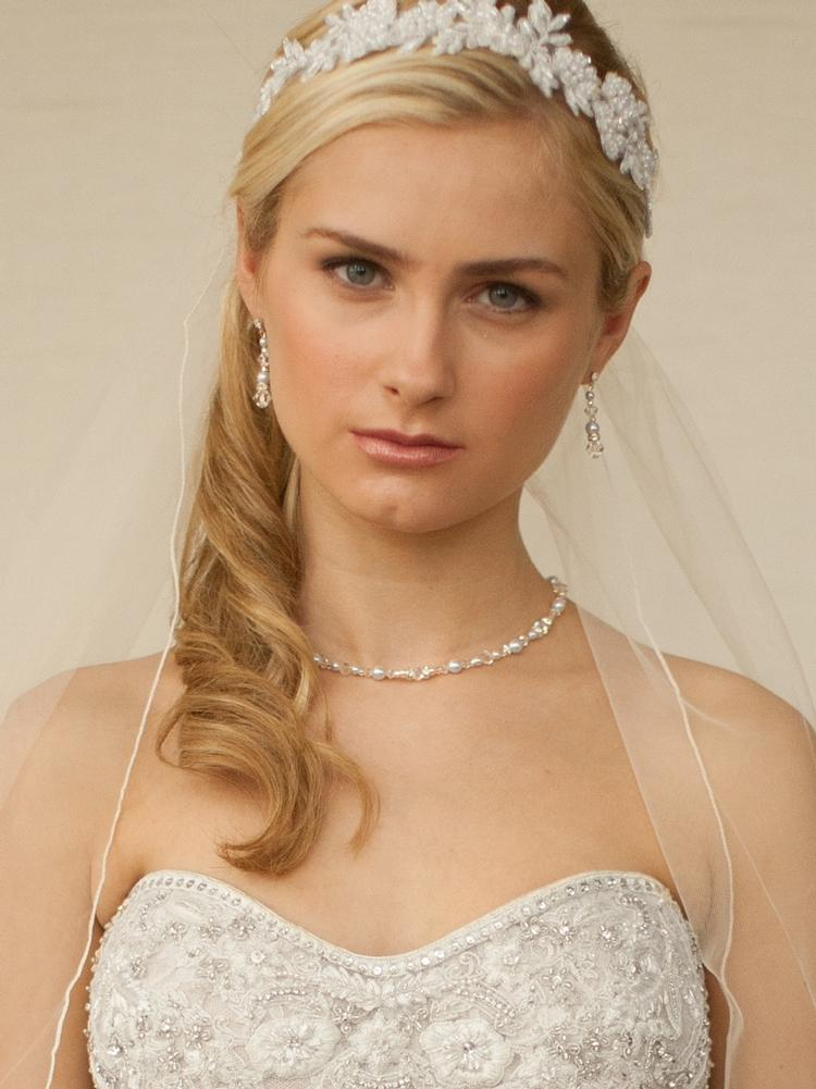 Bride Wearing Crystal and Ivory Pearl Backdrop Necklace - Love Wedding Shop