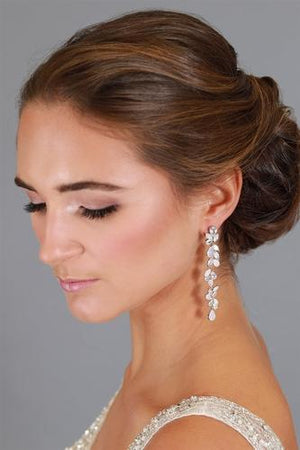 Bride Wearing Platinum Plated CZ and Opal Long Dangle Wedding Earrings - Love Wedding Shop