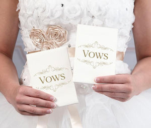 Bride Holding Set of 2 Ivory Satin Wedding Vow Books  - Love Wedding Shop