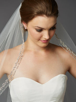 Bride Wearing Ivory Fingertip Length Double Beaded Edge Veil - Love Wedding Shop