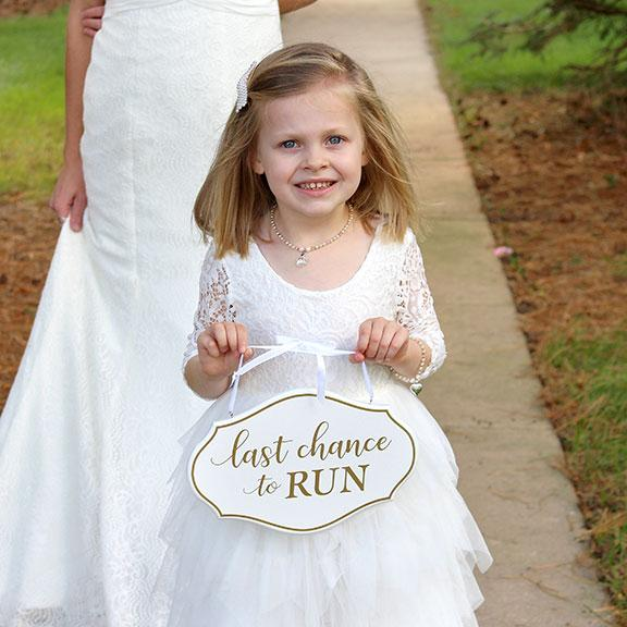 Little Girl Carrying White and Gold Last Chance to Run Wedding Sign - Love Wedding Shop