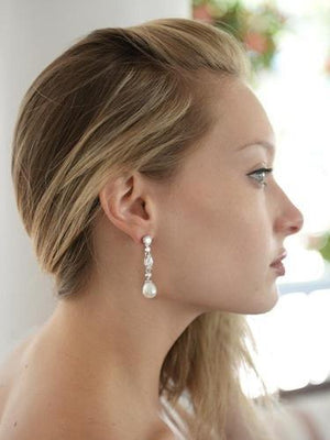 Bride Wearing CZ & Ivory Pearl Dangle Wedding Earrings - Love Wedding Shop