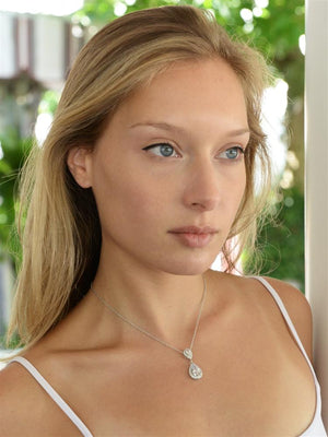 Woman Wearing Silver Plated Cubic Zirconia Teardrop Wedding Pendant - Love Wedding Shop