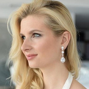 Woman Wearing Silver Plated CZ Dangle Earrings