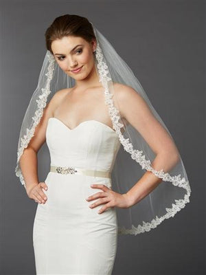 Bride Wearing Ivory Sculpted Lace Edge Fingertip Veil - Love Wedding Shop