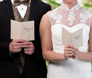 Bride and Groom Holding Tan Canvas Wedding Vow Books - Love Wedding Shop