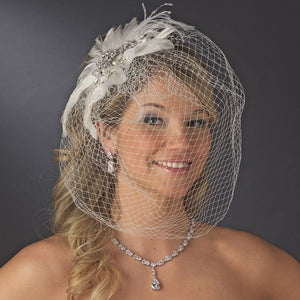 Bride Wearing Crystal and Pearl Feather Fascinator Birdcage Veil - Love Wedding Shop