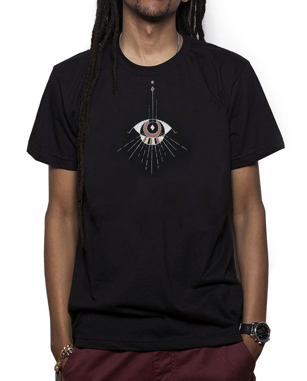 Man wearing comfortable Black Unisex T, Poly Cotton blend.  Abstract Eye pattern draping from neckline.