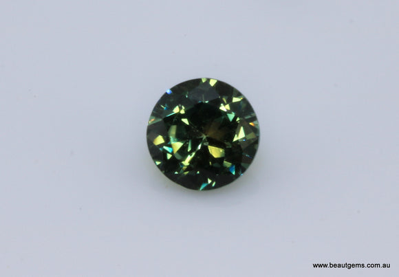 0.55 carat Australia Bi-colour Green and Yellow Parti Sapphire