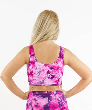 Woman wearing a pink and purple tie dye crop tank by Akasha Sun.