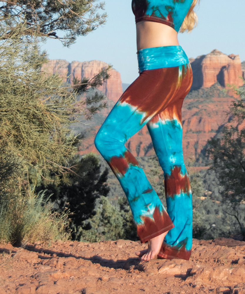 Teal and brown tie dye yoga pants with a fold over waistband by Akasha Sun.